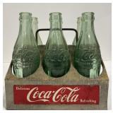 Vintage Coca Cola bottles in carrier