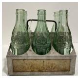 Vintage Coca Cola bottles and carrier