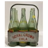 Vintage royal crown pop bottles and metal carrier