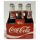 Vintage crimson tide Coca Cola bottles In carrier