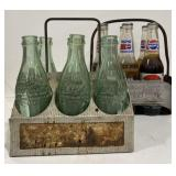 Various vintage pop bottles and carriers