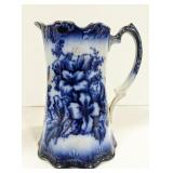 Flow blue pitcher, unmarked. Measuring 8 inches