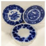 Lot of three blue and white plates. One marked