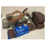 Black and Decker Handheld Belt Sander with belts