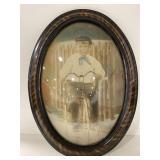 Antique boy riding bike oval bubble frame