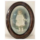 Antique young girl holding a white rode
