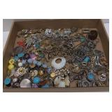 Flat of  various pieces of costume jewelry