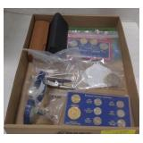 Flat of vary items, including coins, glasses,and