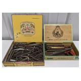 Two vintage cigar boxes filled with allen