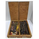 Wood box filled with drill bits and wood drills