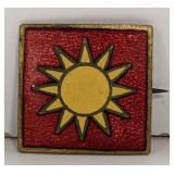 Red and gold pin with Yellow sun, approximately