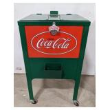 Standing Coca Cola cooler on wheels with bottle