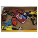 Flat of various toy cars trucks and plane