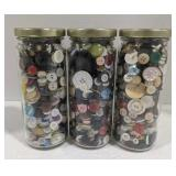 Three jars of various buttons