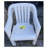 3 white plastic chairs