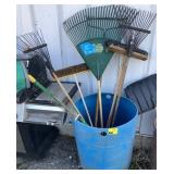 Lot of assorted brushes and rakes bucket not