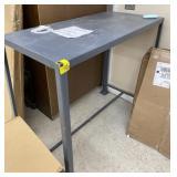 """Metal table  42 1/2"""" high x 4"""
