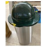 Trash can with dented lid