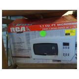 RCA Microwave in box.  Untested