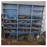 Shelf of Old Machinery Spinning Molds.  Bidding