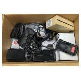 Box of old cell phones, cell phone holders and