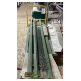 Cart of green posts for shelving  and more