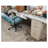 Desk lot and rolling office chair .  Contents on