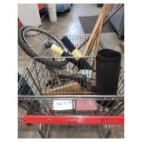 Shopping cart with various items - push brooms ,