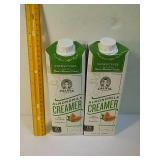 Two bottles of almond milk creamer