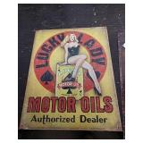 Sc19 lucky lady motor oils tin sign 16 x 12 and a