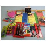 Coca-Cola pen, colored pencils, paper pads, pens,