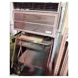 Rolling metal cart, window air conditioner