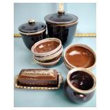 Brown stoneware jars, bowls, butter dish