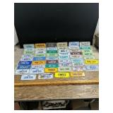 Large variety of 2x5-in license plates 1972-83