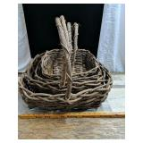 Set of four weaved wood baskets