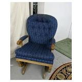 Wood framed upholstered gliding rocking chair