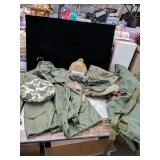 Camouflage and army green clothes a backpack from
