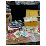 A sewing lot with a sewing box and many pieces of