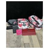 Assorted Mary Kay makeup bags and a wallet