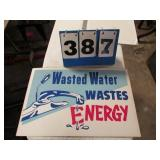CARDBOARD -- WASTED WATER SIGN