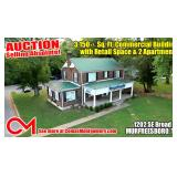 SELLING ABSOLUTE! 3,150+/- Sq. Ft. Commercial Building with Retail Space and 2 Apartments on 0.86+/- Acre Lot