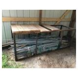 Metal Framed Countertop & Large Collection of Tomato Poles