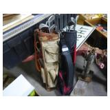 2 golf bags w/ clubs