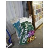 Partial bag potting soil & rocks