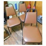 Three padded stackable metal brown chairs, nice