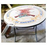 "NRA patio folding table, 35.5"" diameter, 31"" high"