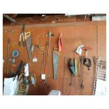 All contents on wall: hand saws - plumb line -