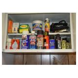 All items in cabinet above washer & dryer