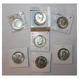 Seven Silver Kennedy Half Dollar Coins