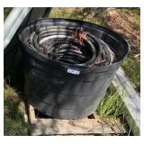 large bucket of hoses